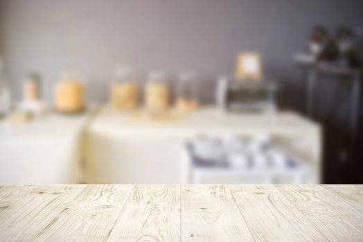 Empty wooden board table top on blur abstract of restaurant or catering background, for montage product or display, mock up for display of product