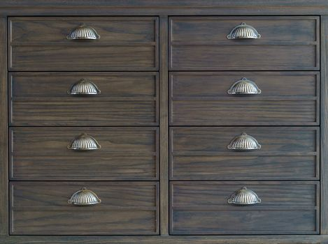 Brown wooden filing cabinets with drawers.