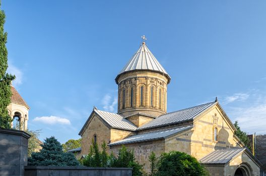 Temple of the Georgian Orthodox Church on a background of blue s