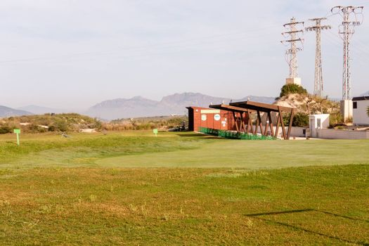 Torrevieja, Valenciana, Spain - May 04 2020 : putting green and driving range empty on golf course in spain, due to covid-19 lock down