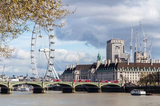 Cityscape of London including London Eye and Westminster Bridge on Thames River