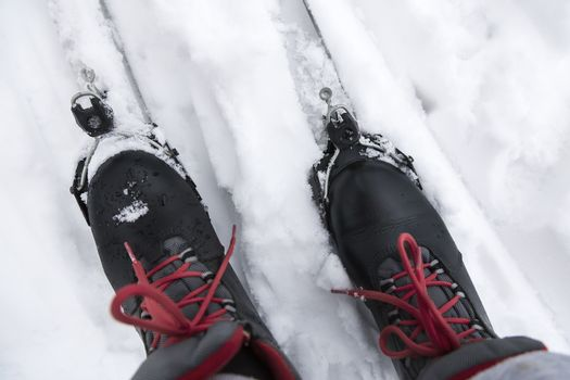 Ski boots and skis in the snow.