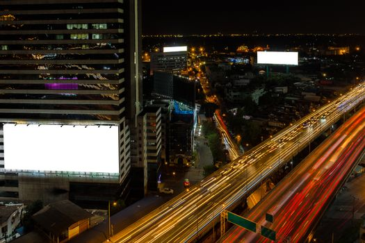 White billboard and cityscape expressway