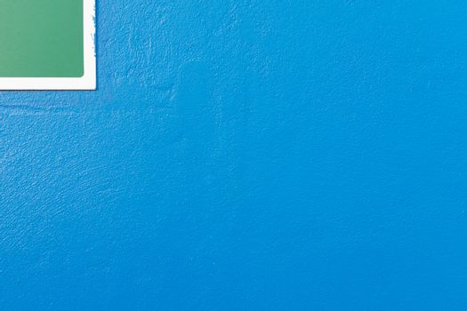 Minimalism style, Blue wall with green label.