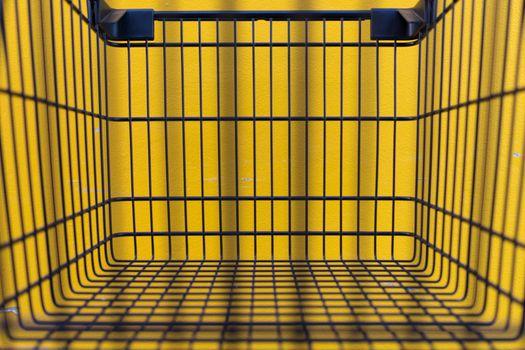 Minimalism style, Shopping cart and yellow wall.