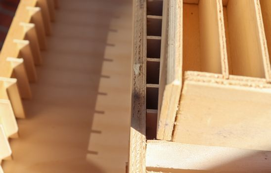 Small wooden boxes for audio tapes in a close up perspective vie