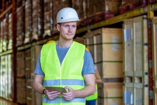 Technician works in merchandise trade in logistics