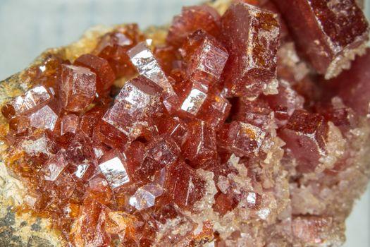 reddish vanadite crystals on bedrock