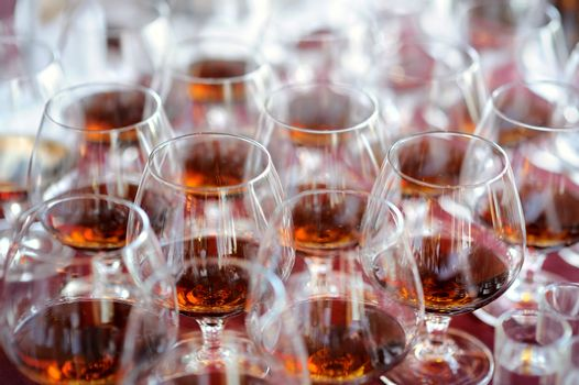 Lots of glasses with brandy