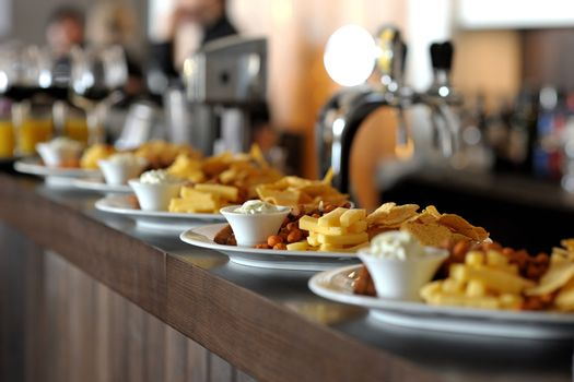 Dishes with snacks on bar counter