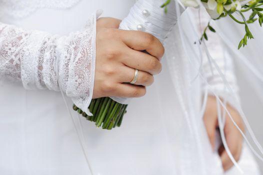 Golden ring on bride's finger