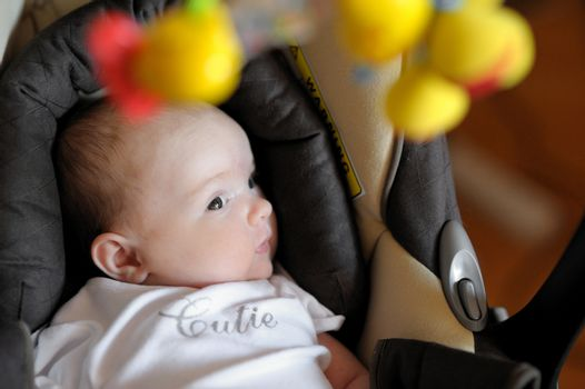 Little two month old baby in a carseat