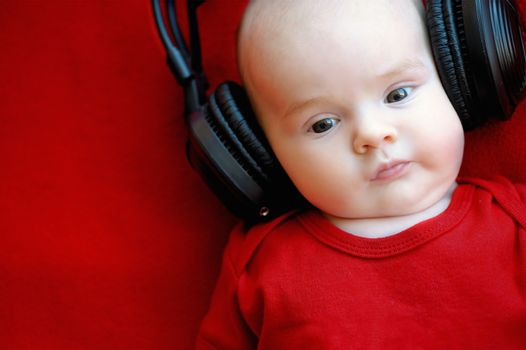 Two month old baby with earphones