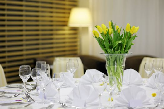 Yellow tulips on a festive table