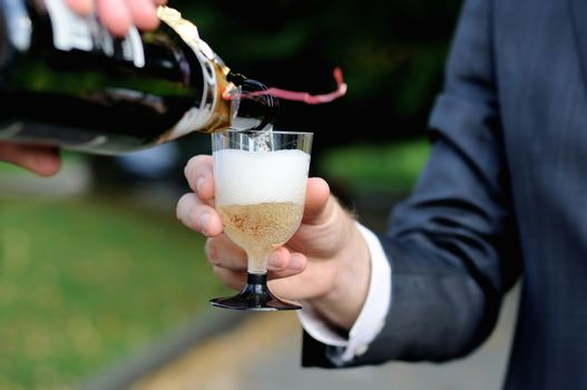 Pouring champagne into a champagne glass
