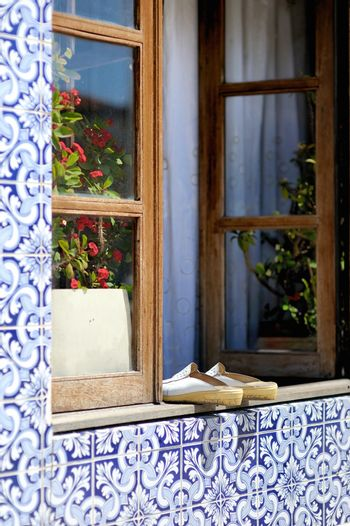 Old shoes on the portuguese window