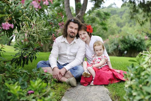 Happy family in a tropical scenery