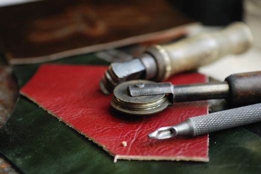 Piece of leather and some tools