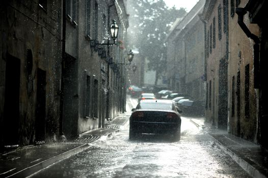 A car under a rain in the city