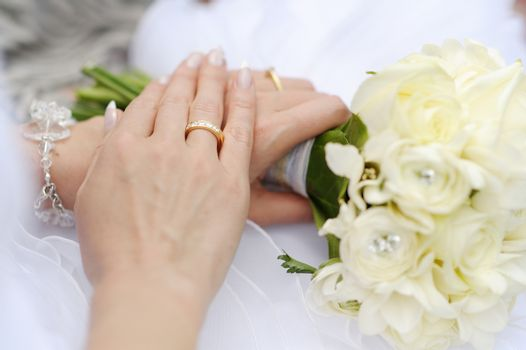 Bride's hand with a wedding ring