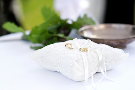 Two wedding ring on a pillow