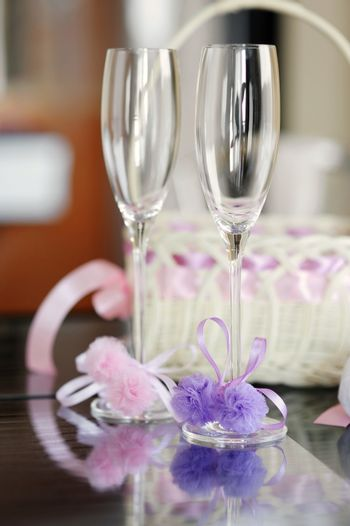 A pair of wedding glasses and a basket