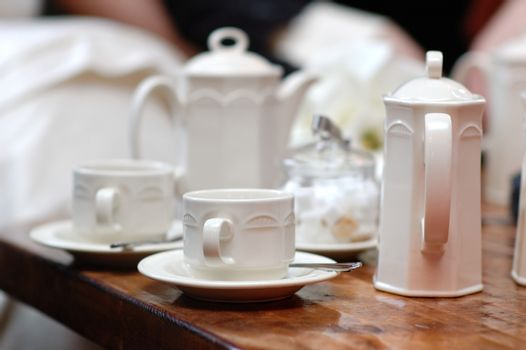 White cups and teapot set