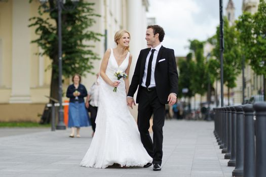 Bride and groom walking in a town