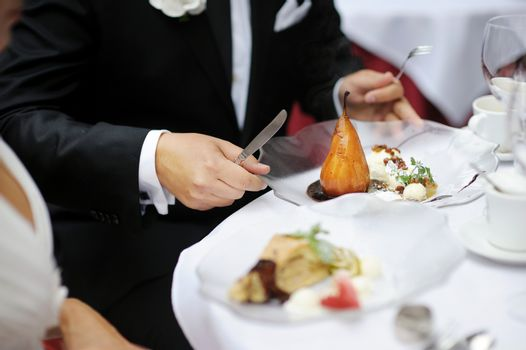 Eating poached pear at a restaurant
