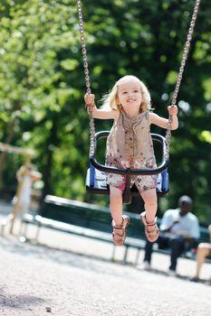 Swinging preschooler girl