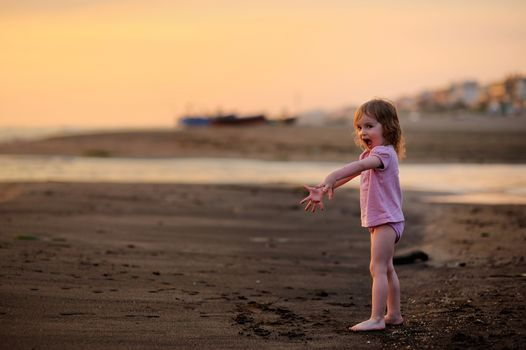 Laughing child having fun on a beach