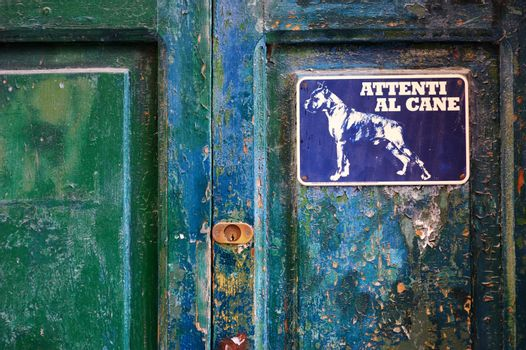 Angry dog sign on a door