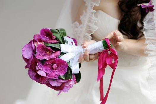 Bride holding beautiful bridal bouquet