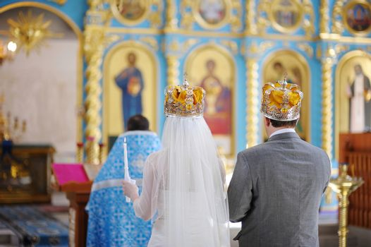 Bride and groom in an orthodox church