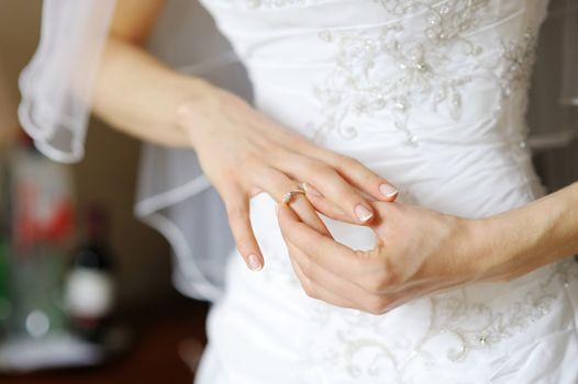 Bride adjusting her wedding ring