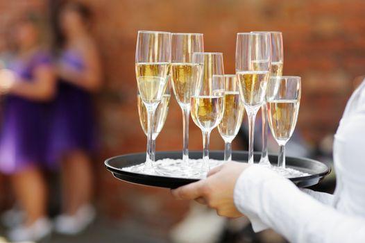 Waiter serving champagne