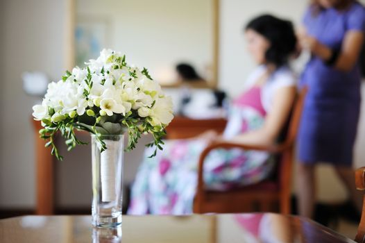 Bridal bouquet and a bride on a background