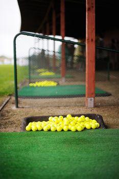Lots of golf balls on a golf field