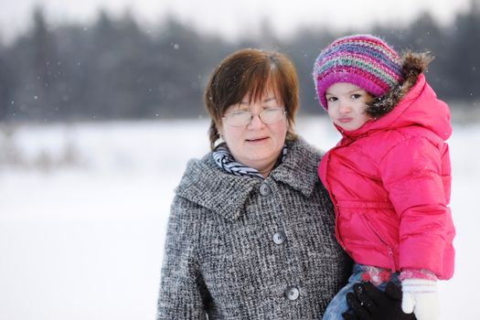 Grandmother and a girl at winter