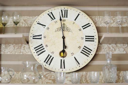 Clock closeup in decorated living room