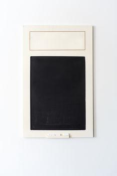 A chalk board on a wall