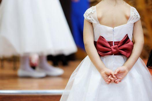 Beautiful bow on flower-girl's dress