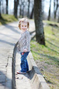 Adorable toddler girl having a walk