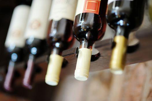 Upside down wine bottles in a bar