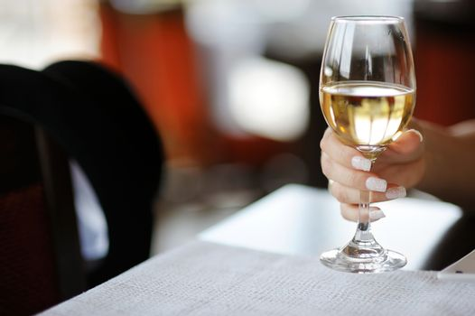 Woman's hand with a glass of wine