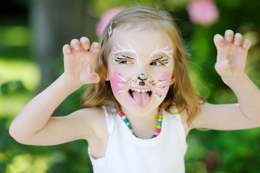 Adorable little girl with her face painted