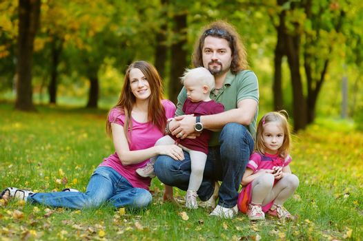 Family of four at autumn