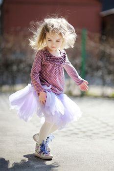 Adorable girl having fun on spring
