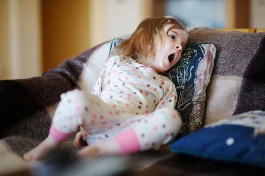 Little sleepy girl in pajamas