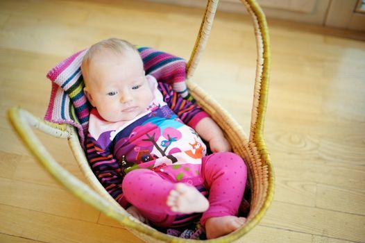 Baby girl lying in a basket